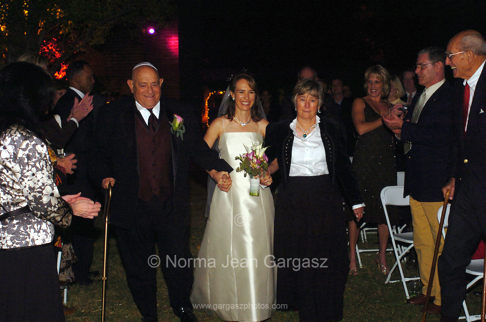 Arizona Congresswoman, Gabrielle Giffords, (center), and space shuttle commander, Mark Kelly were married in Amado, Arizona, USA, on November 10, 2007.  Giffords parents, Spencer J. Giffords, (left), and Gloria Kay Giffords, escort their daughter at the ceremony.