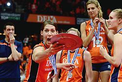 04-10-2015 NED: Volleyball European Championship Final Nederland - Rusland, Rotterdam<br /> Nederland verliest kansloos de finale met 3-0 van Rusland en moet genoegen nemen met zilver / Robin de Kruijf #5 hoef de zilveren schaal eigenlijk niet