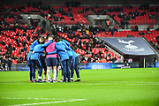 Tottenham Hotspur players have a team talk ahead of the The FA Cup 4th round replay match between Tottenham Hotspur and Newport County at Wembley Stadium, London, England on 7 February 2018. Picture by Stephen Wright.