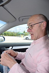 Man doing a Covid-19 test at a drive in centre, Lowestoft, UK May 2020. MR