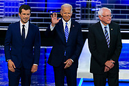 Democratic presidential candidates Mayor of South Bend Pete Buttigieg, former Vice President Joe Biden and Sen. Bernie Sanders (I-VT) attend the start of the first primary debate for the 2020 elections at the Adrienne Arsht Center for the Performing Arts in downtown Miami on Thursday, June 27, 2019.