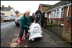 Residents in Egham collect sandbags as floods hit the town, United Kingdom, Wednesday, 12th February 2014. Picture by Andrew Parsons / i-Images