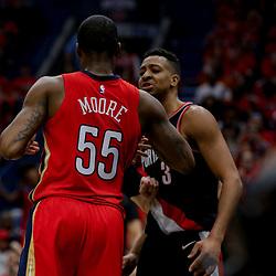 Apr 21, 2018; New Orleans, LA, USA; New Orleans Pelicans forward E'Twaun Moore (55) and Portland Trail Blazers guard CJ McCollum (3) argue after a flagrant foul during the second quarter in game four of the first round of the 2018 NBA Playoffs at the Smoothie King Center. Mandatory Credit: Derick E. Hingle-USA TODAY Sports