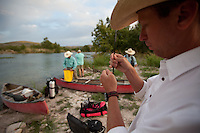 ANGLER TYING ON A FLY DEVILS RIVER TEXAS