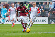 Hearts FC Midfielder Prince Buaben plays the ball forward during the Ladbrokes Scottish Premiership match between Heart of Midlothian and Ross County at Tynecastle Stadium, Gorgie, Scotland on 24 October 2015. Photo by Craig McAllister.