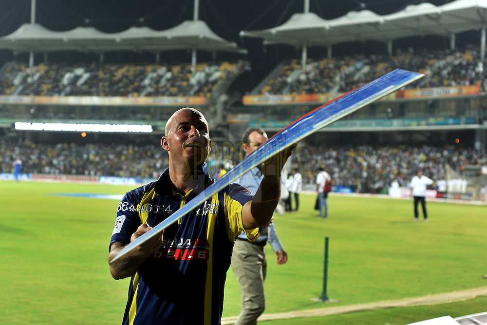 Herschelle Gibbs of Cape Cobras does an action of throwing the Prize money cheque at the crowd  award  during match 2 of the NOKIA Champions League T20 ( CLT20 )between the Cape Cobras and the New South Wales Blues held at the M. A. Chidambaram Stadium in Chennai , Tamil Nadu, India on the 24th September 2011..Photo by Pal Pillai/BCCI/SPORTZPICS