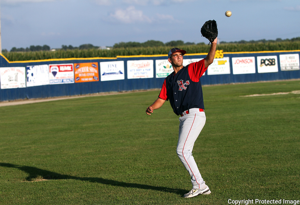 Jake Hovis warms up in the Municipal Stadium outfield prior to the Clarinda A's game with the Omaha Diamond Spirit in late July.  photo by David Peterson