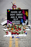 Flowers, signs and candles on the spot where unarmed Michael Brown (18) died after being shot by a police officer.