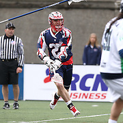 Kevin Buchanan #27 of the Boston Cannons follows through on his shot during the game at Harvard Stadium on April 27, 2014 in Boston, Massachusetts. (Photo by Elan Kawesch)