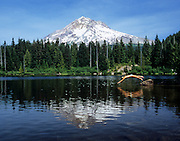 Swimmer diving into Lost Lake with Mt. Hood in background.