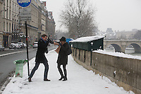 Paris snow-Jan 2013. couple having a snow ball fight near the banks of the Seine