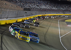 September 14, 2018 - Las Vegas, NV, U.S. - LAS VEGAS, NV - SEPTEMBER 14: Grant Enfinger (98) Champion Power Equipment, Curb Records Curb Racing Ford F-150 leads the field into turn one during the NASCAR Camping World Truck Series Playoff Race World of Westgate 200 on September 14, 2018, at the Las Vegas Motor Speedway in Las Vegas, NV. (Photo by Chris Williams/Icon Sportswire) (Credit Image: © Chris Williams/Icon SMI via ZUMA Press)