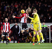 Brentford striker Phillip Hofmann controlling the ball to set up a Brentford attack during the Sky Bet Championship match between Brentford and Nottingham Forest at Griffin Park, London, England on 21 November 2015. Photo by Matthew Redman.