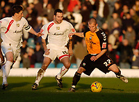 Photo: Leigh Quinnell.<br /> Milton Keynes Dons v Barnet. Coca Cola League 2. 20/01/2007. Barnets Adam Birchall holds off MK Dons Scott Taylor.