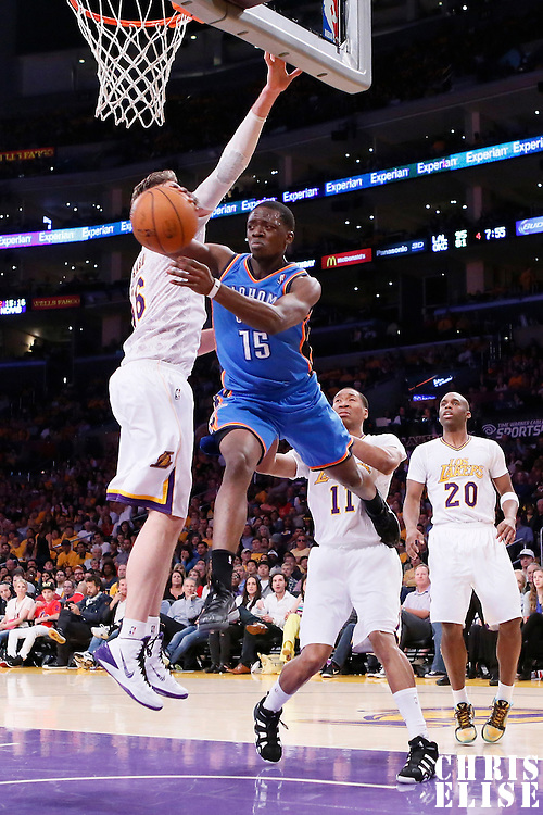 09 March 2014: Oklahoma City Thunder point guard Reggie Jackson (15) passes the ball while in the air around Los Angeles Lakers center Pau Gasol (16) during the Los Angeles Lakers 114-110 victory over the Oklahoma City Thunder at the Staples Center, Los Angeles, California, USA.