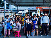 25 SEPTEMBER 2017 - RANGSIT, PATHUM THANI, THAILAND: People in line to board minivans that take commuters in Bangkok from Rangsit.       PHOTO BY JACK KURTZ