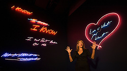 """© licensed to London News Pictures. London, UK. 16/05/2011. Tracey Emin poses underneath her title piece """"Love is What You Want"""" (right)  at a photo call for the preview of Tracey Emin's new exhibition """"Love is What You Want"""" at Hayward Gallery, Southbank, London today (16/05/2011).  Photo credit should read Ben Cawthra..."""
