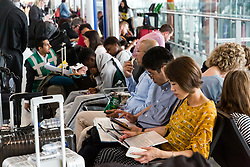Every one of the available seats is taken as passengers await news on their flights at Terminal 5, Heathrow Airport after an IT glitch brings British Airways systems to a halt, causing disruption to thousands of passengers with flights cancelled and delayed. London, August 07 2019.