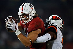 PALO ALTO, CA - NOVEMBER 10: Tight end Colby Parkinson #84 of the Stanford Cardinal catches a pass for a touchdown past cornerback Dwayne Williams #4 of the Oregon State Beavers during the first quarter at Stanford Stadium on November 10, 2018 in Palo Alto, California. (Photo by Jason O. Watson/Getty Images) *** Local Caption *** Colby Parkinson; Dwayne Williams