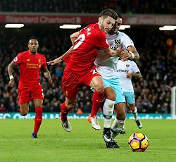 Adam Lallana of Liverpool challenges Dimitri Payet of West Ham United - Mandatory by-line: Matt McNulty/JMP - 11/12/2016 - FOOTBALL - Anfield - Liverpool, England - Liverpool v West Ham United - Premier League