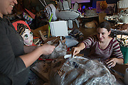 India Mitchell, right, assists Seana Higgins as she pastes paper on a puppet for Honey of the Heart at the Central Avenue Venue on Oct. 15, 2014. Photo by Lauren Pond