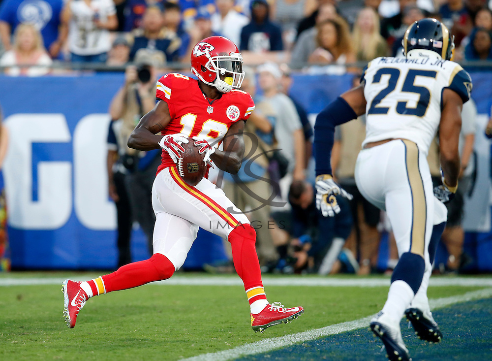 Kansas City Chiefs wide receiver Jeremy Maclin, left, runs in for a touchdown after catching a pass as Los Angeles Rams strong safety T.J. McDonald runs toward him during the first half of a preseason NFL football game, Saturday, Aug. 20, 2016, in Los Angeles. (AP Photo/Rick Scuteri)