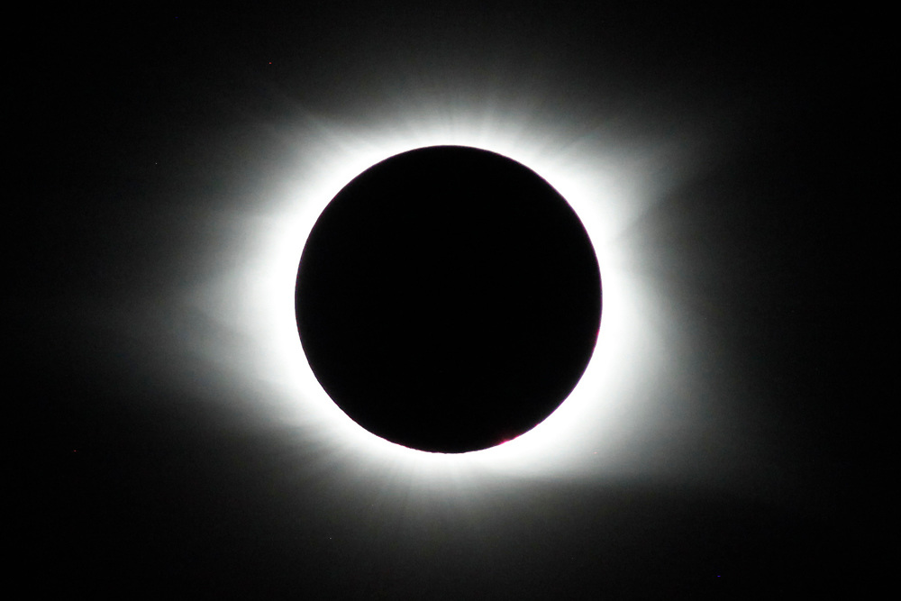 The total solar eclipse hangs Monday over Isle of Palms. Andrew Knapp/Staff
