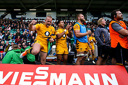 Tom Cruse, Marcus Watson and Brad Shields of Wasps celebrate as their teammates on the field hold on to victory over Northampton Saints - Mandatory by-line: Robbie Stephenson/JMP - 28/09/2019 - RUGBY - Franklin's Gardens - Northampton, England - Northampton Saints v Wasps - Premiership Rugby Cup