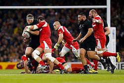 New Zealand Prop Wyatt Crockett is tackled by Georgia Flanker Mamuka Gorgodze (capt) - Mandatory byline: Rogan Thomson/JMP - 07966 386802 - 02/10/2015 - RUGBY UNION - Millennium Stadium - Cardiff, Wales - New Zealand v Georgia - Rugby World Cup 2015 Pool C.