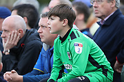 Young AFC Wimbledon fan looking on during the EFL Sky Bet League 1 match between AFC Wimbledon and Rochdale at the Cherry Red Records Stadium, Kingston, England on 30 September 2017. Photo by Matthew Redman.