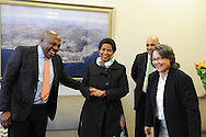CAPE TOWN, SOUTH AFRICA - Friday 22 August 2014, Dr Phumzile Mlambo-Ngcuka, Under-Secretary-General and Executive Director of UN (United Nations) Women from New York and former South African Deputy President, greets new national soccer coach, Ephraim &quot;Shakes&quot; Mashaba (left) with Executive Mayor of Cape Town, Patricia De Lille (right) in an impromptu meeting during the announcement that the City of Cape Town will join the United Nations Women Safe Cities Global Initiative designed to assist local authorities in making cities safer for women and girls. Cape Town is the first city in southern Africa to join the UN Women Safe Cities Global Initiative, and looks forward to learning from and sharing its experiences with other international cities and African counterparts in Kigali and Nairobi.<br /> Photo by Roger Sedres/ImageSA