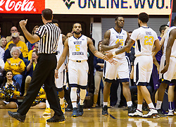 Feb 13, 2016; Morgantown, WV, USA; West Virginia Mountaineers guard Jaysean Paige (5) celebrates with forward Esa Ahmad (23) during the first half against the TCU Horned Frogs at the WVU Coliseum. Mandatory Credit: Ben Queen-USA TODAY Sports