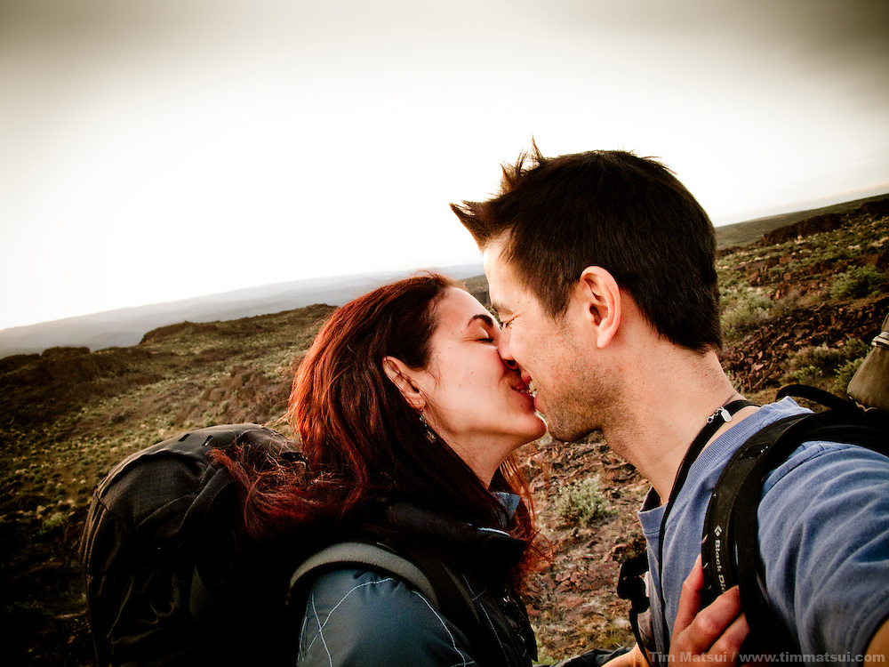 THIS PHOTO IS AVAILABLE EXCLUSIVELY FROM AURORA PHOTOS; LICENSING MUST GO THROUGH AURORA.<br /> Visit Aurora and Keyword &quot;Tim Matsui&quot; <br /> http://www.auroraphotos.com / +1.207.828.8787<br /> <br /> Couple kisses while backpacking through the desert.