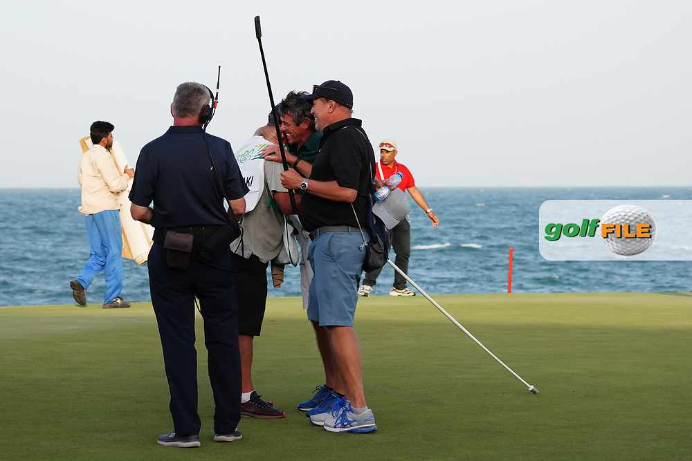 Kyle Roadley celebrates with Brian Nilsson after winning the Oman Open 2020 at the Al Mouj Golf Club, Muscat, Oman . 01/03/2020<br /> Picture: Golffile | Thos Caffrey<br /> <br /> <br /> All photo usage must carry mandatory copyright credit (© Golffile | Thos Caffrey)