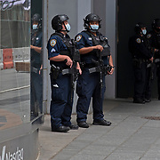 New York City police officers remain on guard in Times Square in preparation for another expected night of protests due to the killing of George Floyd by a Minnesota Police Officer on Tuesday, June 2, 2020 in Manhattan, New York.  A citywide 8 p.m. curfew was ordered by NY Mayor Bill de Blasio amid the Floyd protests. (Alex Menendez via AP)