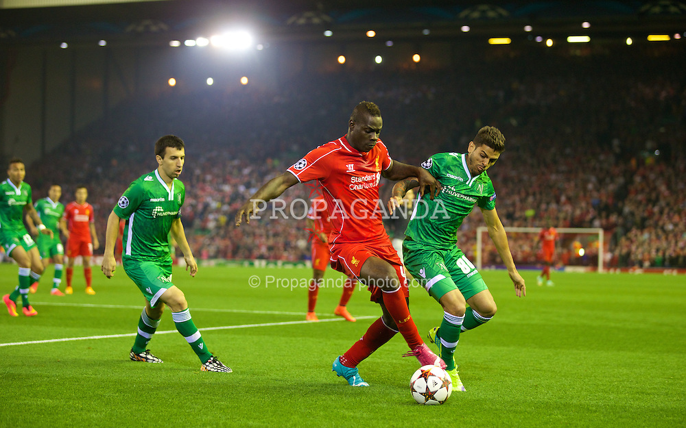 LIVERPOOL, ENGLAND - Tuesday, September 16, 2014: Liverpool's Mario Balotelli in action against PFC Ludogorets Razgrad's Junior Caicara during the UEFA Champions League Group B match at Anfield. (Pic by David Rawcliffe/Propaganda)