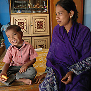 Shaifula (6) and his mother in their home in one of Bangalore's slum areas. Shaifula is mentally retarded and APD is helping with his education in the last six months.