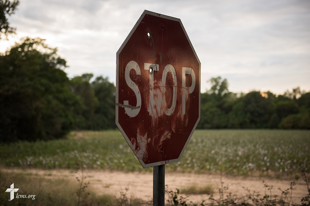 A damaged stop sign anchors a country dirt road as a film crew (not pictured) prepares a scene during the final day of filming for 'The First Rosa' documentary on Thursday, September 25, 2014, near Selma, Ala. LCMS Communications/Erik M. Lunsford