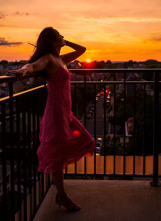 Portrait of pretty Asian girl posing sexy on balcony. 2018