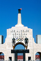 May 10, 2003; Los Angeles, CA, USA; Los Angeles Memorial Coliseum with a lit torch. 3911 South Figueroa Street. Opened to the public in June 1923.  First football game played on October 6, 1923 by USC hosting Pomona College before a crowd of 12,836.  Hosted the Xth and XIIIrd Olympiads, Superbowl I and VII and the 1959 World Series.  Former home for the NFL LA Rams 1946-1979, MLB Dodgers 1958-1961, AFL SD Chargers, NFL LA Raiders 1982-1994. Currently serves as home field for USC Trojan football since 1923 and other current world-class events. Seats 92,516 people.