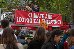 London, UK. 1st May, 2019. Journalist and commentator Owen Jones addresses climate protesters at a Declare A Climate Emergency Now demonstration in Parliament Square organised to coincide with a motion in the House of Commons to declare an environment and climate emergency tabled by Leader of the Opposition Jeremy Corbyn. The motion, which does not legally compel the Government to act, was passed without a vote.