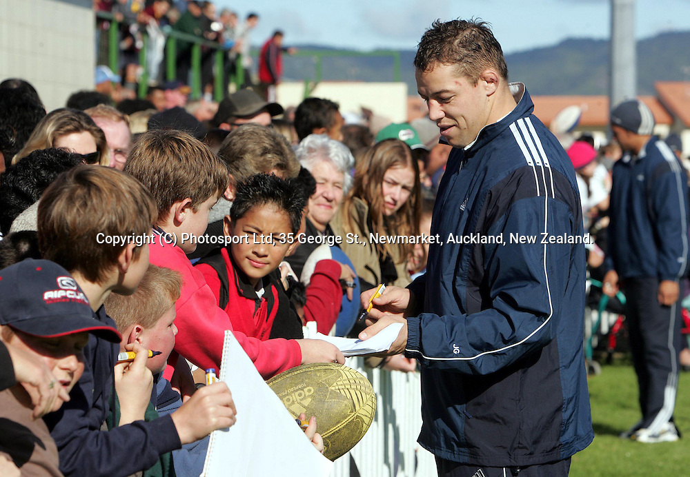 All Black Jono Gibbes signs autographs for the fans who turned out to watch the All Blacks training session at Waitemata Rugby Club, Henderson on Monday 14 June, 2004. <br />