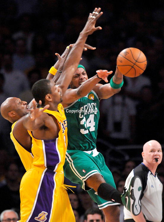 Paul Pierce passes the ball away from Lamar Odom and Ron Artest in the first half. The Lakers defeated the Boston Celtics in game 7 of the NBA Finals  83-79 in Los Angeles, CA 06/16/2010 (John McCoy/Staff Photographer).