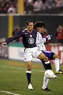 10 February 2006: Landon Donovan (10), of the United States, and Japan's Yuji Nakazawa. The United States Men's National Team defeated Japan 3-2 at SBC Park in San Francisco, California in an International Friendly soccer match..