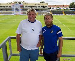 Bristol Rovers' Stuart Sinclair has his photo taken with a fan - Photo mandatory by-line: Dougie Allward/JMP - Mobile: 07966 386802 27/07/2014 - SPORT - FOOTBALL - Bristol - Bristol Rovers - - Memorial Stadium - Fun Day