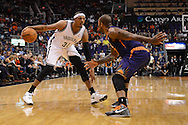 Nov 15, 2013; Phoenix, AZ, USA; Brooklyn Nets forward Paul Pierce (34) handles the ball against the Phoenix Suns forward P.J Tucker (17) at US Airways Center. The Nets defeated the Suns 100-98 in overtime. Mandatory Credit: Jennifer Stewart-USA TODAY Sports