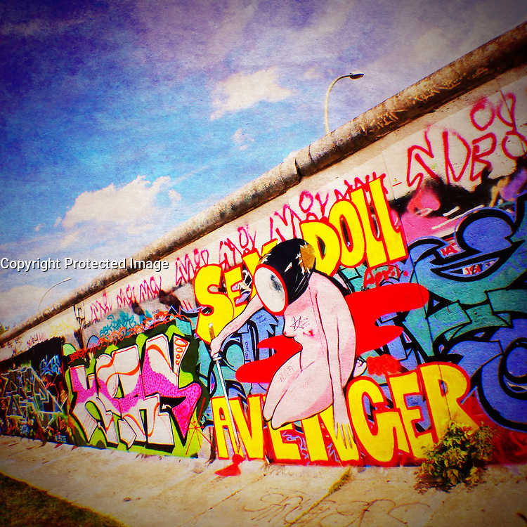 Graffiti on Berlin Wall at East Side Gallery in Berlin Germany