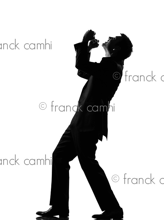 silhouette caucasian business man  expressing anger adversity despair looking up behavior full length on studio isolated white background