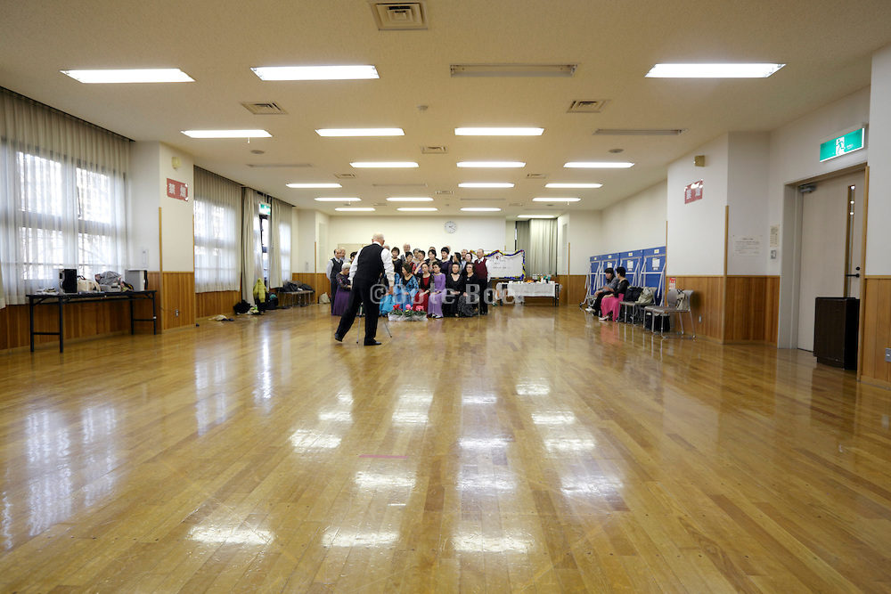 seniors meeting of recreational dance group making a memorial portrait Japan
