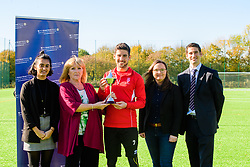 Lincoln City's Tom Pett has been presented with his PFA Bristol Street Motors Fans Player of the Month award for September.  Pictured is, from left, Bristol Street Motor's marketing graduate Levina Basra, Lincoln City fan Steph Uglow, Lincoln City's Tom Pett, Bristol Street Motors online content manager Tania Henzell and PFA commercial executive Phil Baylis.<br /> <br /> Picture: Chris Vaughan Photography<br /> Date: October 18, 2018